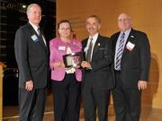 Charlie Foley (left) of sponsor Battelle & Battelle and Ken Maisch (right) of sponsor TechSolve presented the second award to Bill Rosenberg and Bonnie Bey of Process Equipment Co. at the 2013 DBJ Manufacturing Awards Event at the Schuster Center.