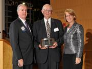 Charlie Foley (left) of sponsor Battelle & Battelle and Carol Clark (right) of the Dayton Business Journal presented the fourth award to Dick Schaefer of The Schaefer Group at the 2013 DBJ Manufacturing Awards Event at the Schuster Center.