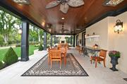 The huge covered terrace is 42 feet by 18 feet, with ceiling fans and heaters to keep comfortable no matter the weather.