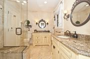 The master bathroom has plenty of space for two with separate sinks and a walk-in shower with seat.