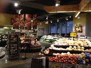 The Dominick's store of the future features track lighting and hardwood floors in the produce and deli departments.