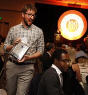 An unidentified employee from Substantial picks up the company's award at the Puget Sound Business Journal's 100 Fastest-Growing Private Companies Awards on Thursday.