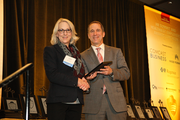 Carrie Strahorn accepts an award from Business Journal Publisher Craig Wessel for Boly:Welch Consulting in the 5-99 employee category.