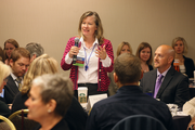 Reine Morris of Kaiser Permanente asks a question during the HR Summit morning sessions.