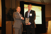 John Phillips, CEO of Grand + Benedicts, accepts an award as winner in the 5-99 employee category.