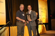 Andrew Krane accepts an award for GloryBee Foods in the 100-499 employee category.