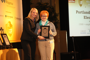 Arleen Barnett (right) accepts an award for Portland General Electric in the 1,500+ employee category.