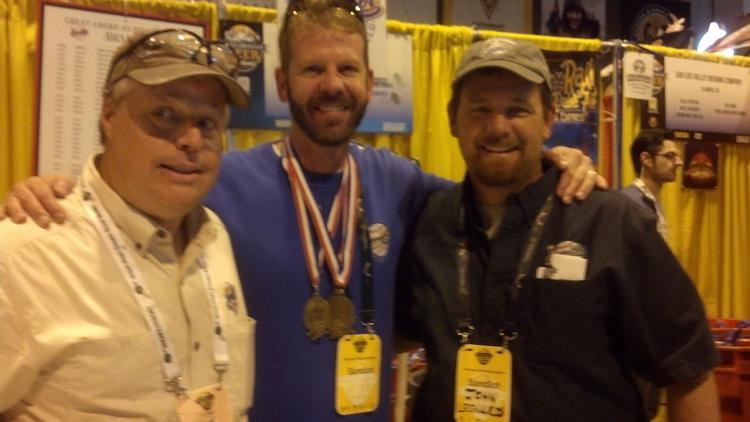 Brewer Tom Hail, apprentice brewer Adam Schwindt and brewmaster John Legnard celebrate the Large Brewery of the Year award captured by the SandLot at the 2013 Great American Beer Festival.