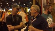 Buddy Schmalz, owner of Dostal Alley brewery, talks with Dry Dock Brewing Co. co-owner Kevin DeLange after Dry Dock won five medals at the 2013 Great American Beer Festival.