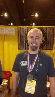 Brian Hutchinson, co-owner of Cannonball Creek Brewing Co., shows off the two medals his 9-month-old brewery won at the 2013 Great American Beer Festival.