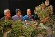 Walt Disney Imagineering's Joe Rohde (right) shares highlights of the project model with filmmaker James Cameron (left) and Walt Disney Parks & Resort Chairman Tom Staggs.