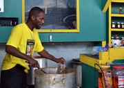 Gerald Sampson, 60, makes boiled peanuts at his booth in the Beaver Street Farmers Market on Friday, Oct. 11, 2013.
