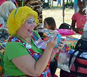 Amy Staley makes balloon bracelet in the Beaver Street Farmers Market on Saturday, Oct. 12, 2013.