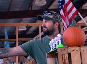 Pete Yarbrough sells pumpkins at his booth in the Beaver Street Farmers Market on Saturday, Oct. 12, 2013.