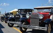 Classic cars are seen in the Beaver Street Farmers Market on Saturday, Oct. 12, 2013.  The market had its 75th anniversary on Friday.