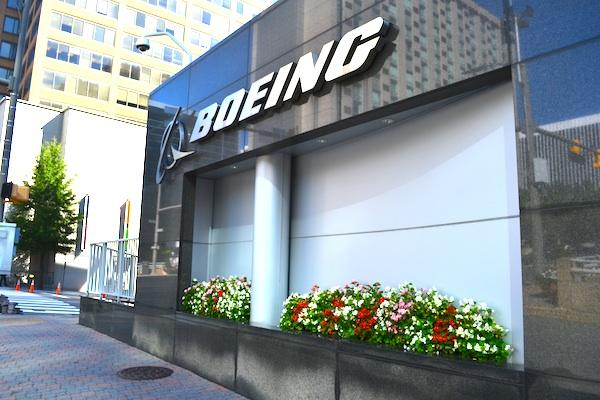 A prolonged government shutdown could impact The Boeing Co. via limited access to military bases, a lack of government inspectors and government funding cuts.