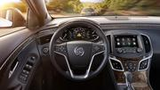 2014 Buick LaCrosse, Adaptive Cruise Control alert displayed in the 8-inch instrument panel (IP). This image also features next-generation IntelliLink infotainment system as well as the Light Neutral Soleil Keisel leather seating and Cocoa accents interior with Kyoto Maple wood-style decor.