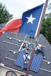 Employees of Texas Solar Outfitters at work installing solar panels