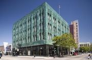 Vigilent moved into the I. Magnin building at 2001 Broadway, an iconic building known for its green terra cotta exterior.