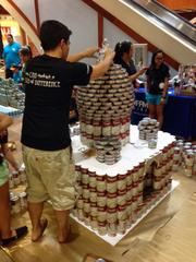 A member of the team from Coffman Engineers works on its replica of the Taj Mahal at AIA Honolulu's Canstruction fundraiser at Pearlridge Center on Oahu.