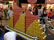 The team from Group 70 International and Swinerton Builders created a model of the traditional Polynesian sailing canoe Hokulea at AIA Honolulu's Canstruction fundraiser at Pearlridge Center on Oahu.