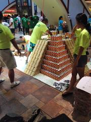 The team from Nordic PCL builds a Mayan pyramid at AIA Honolulu's Canstruction fundraiser at Pearlridge Center on Oahu.