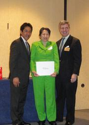 The Arlington Chamber of Commerce honored workers in the Arlington hospitality industry on March 19 at the Crystal Gateway Marriott with the 2013 Hospitality Awards. From left, Walter Tejada, award winner Sylien La of the Key Bridge Marriott and David DeCamp.