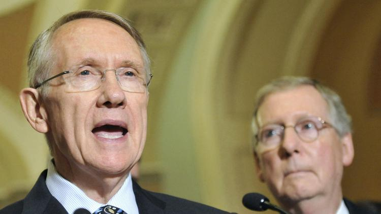 """Senate Majority Leader Harry Reid, D-Nev., left, compared Republicans such as Senate Minority Leader Mitch McConnell to """"greased pigs"""" Tuesday.   and Senate Minority Leader Mitch McConnell, R-Ky., once again bickered over how to run the Senate."""
