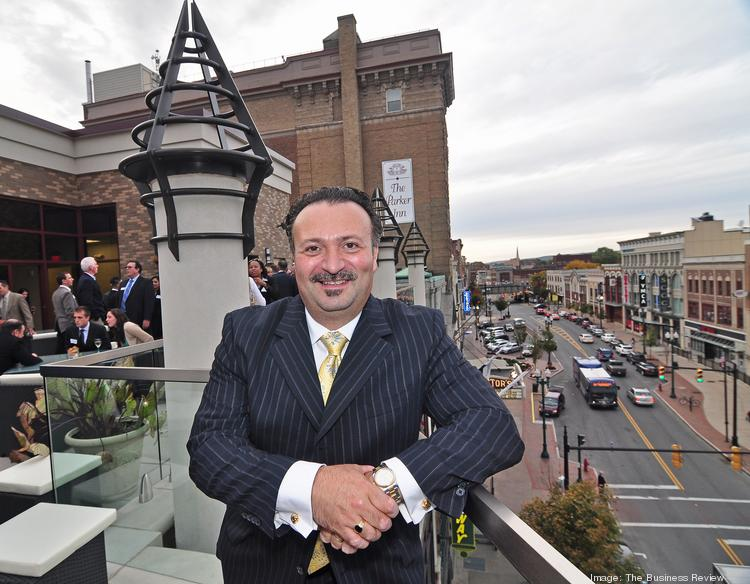 Antonio Civitella, president and CEO of Transfinder, stands on the rooftop terrace of the company's new headquarters on State Street in downtown Schenectady.