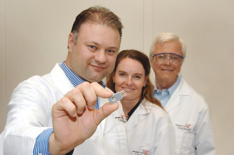 From left: The research team is led by Ian Papautsky (holding current version of the sensor to be developed), an associate professor in the UC College of Engineering and Applied Science's Department of Electrical Engineering and Computer Systems. Other members are Erin Haynes, an assistant professor in the College of Medicine's Department of Environmental Health, and William Heineman, a professor in the McMicken College of Arts and Sciences' Department of Chemistry.