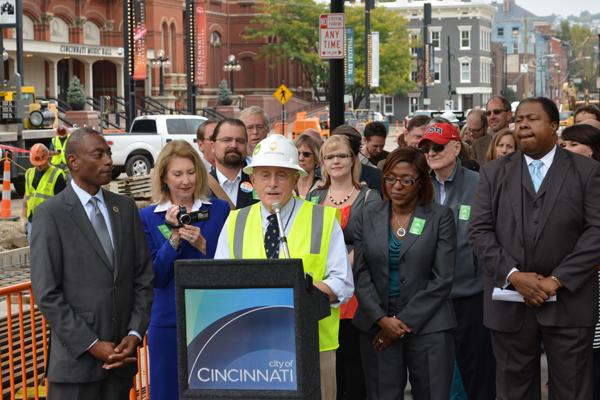 Streetcar supporters stood behind project manager John Deatrick at the placement of the project's first rail earlier this year.