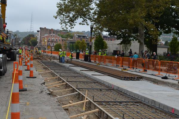 The granite pavers on Elm Street have been removed for the streetcar route to be built. Work is on hold.