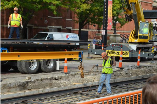 The city of Cincinnati and the contractor building the streetcar are considering whether to work on the project 24 hours a day in the coming weeks because of potential disruptions crossing Liberty Street and reaching Findlay Market.