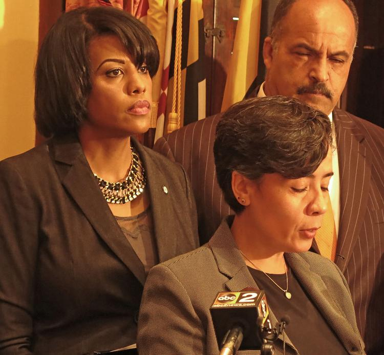 Baltimore Health Commissioner Dr. Oxiris Barbot, front, speaks at a press conference on Tuesday while Mayor Stephanie Rawlings-Blake and Del. Curt Anderson look on.