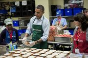 President Barack Obama helped bag sandwiches while visiting furloughed federal workers volunteering at Martha's Table on Oct. 14, including Dolly Garcia with the U.S. Census Bureau, right, and Chantelle Burton with the U.S. Department of Health and Human Services.