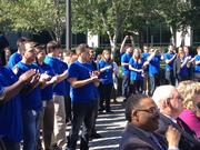Yodlers clap at a grand-opening event at their new Charlotte office.