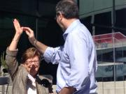 Yodle CEO Court Cunningham high-fives Charlotte Mayor Patsy Kinsey at his company's grand-opening event at its new Charlotte office.