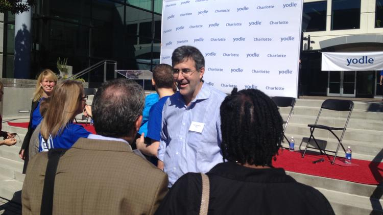 Yodle CEO Court Cunningham greets guests at a 2013 grand-opening event at his company's new Charlotte office.