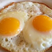 A pair of eggs, sunny side up, actually come with the biscuits and gravy