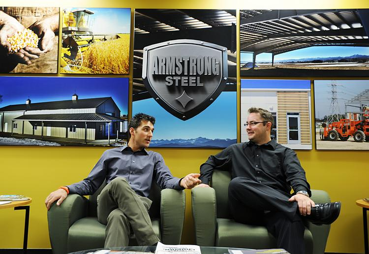Eric Beavers, vice president of operations, and Charles Nelson, graphic designer, at Armstrong Steel.