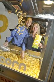 Rob and Renee Israel, founders of Doc Popcorn, in their location in FlatIron Crossing Mall in Broomfield. (October 2013)