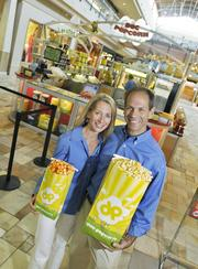 Fastest-growing Private Companies 2013 - Flight III, No. 1: Doc Popcorn Renee and Rob Israel, founders of Doc Popcorn, in their location in Flatiron Crossing Mall in Broomfield.