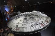 A model of the Millennium Falcon on display. You'll also see a model of the X-wing.