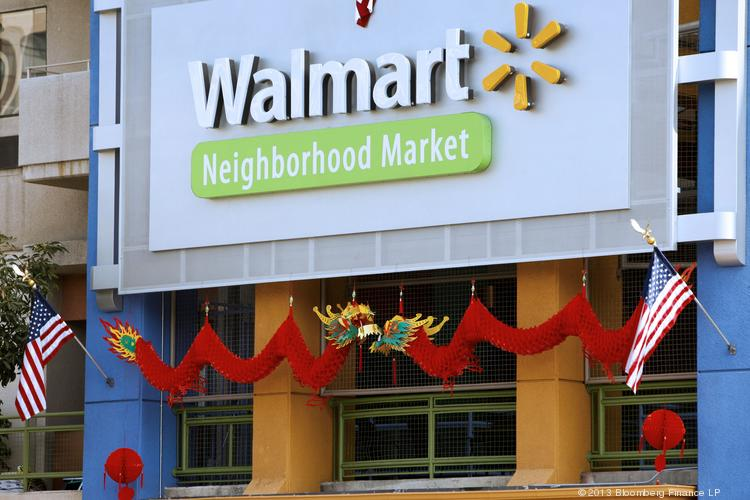 Wal-Mart Stores Inc. signage is displayed outside outside of a store during the grand opening of a location in the Chinatown neighborhood of Los Angeles, California, U.S., on Thursday, Sept. 19, 2013. Photographer: Patrick T. Fallon/Bloomberg