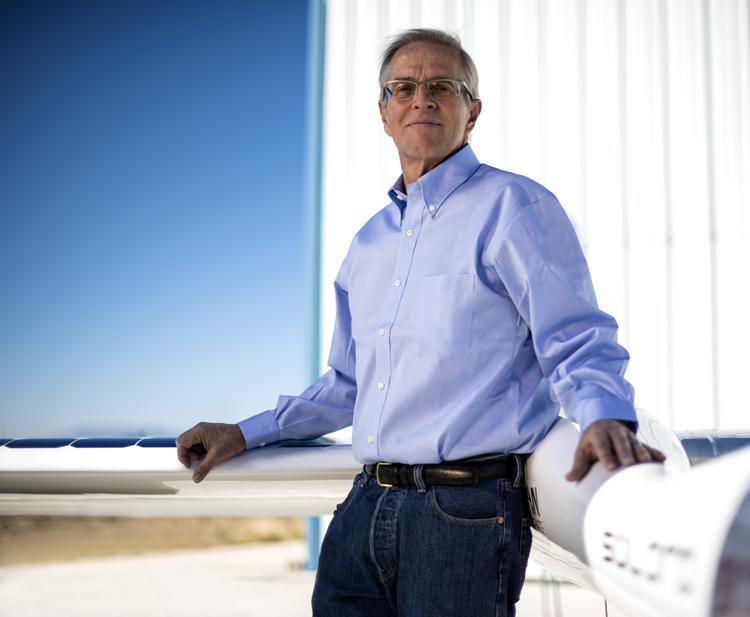 "Vern Raburn, who's been tapped as CEO of unmanned flying vehicle startup Titan Aerospace, is shown with a prototype of Titan's ""atmospheric satellites."""