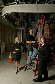 From left, Alissa Leinonen, owner of Gourmondo,  Keith Haney, of Columbia Fire (who is installing sprinklers) and Martin Selig.