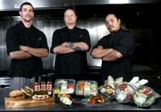 From left, Gourmondo's Cafe Sous Chef Brian Reich, Production Sous Chef Ben Blanchard and Catering Sous Chef Daryl Babauta with some of the items that will be available at the new Gourmondo Cafe.
