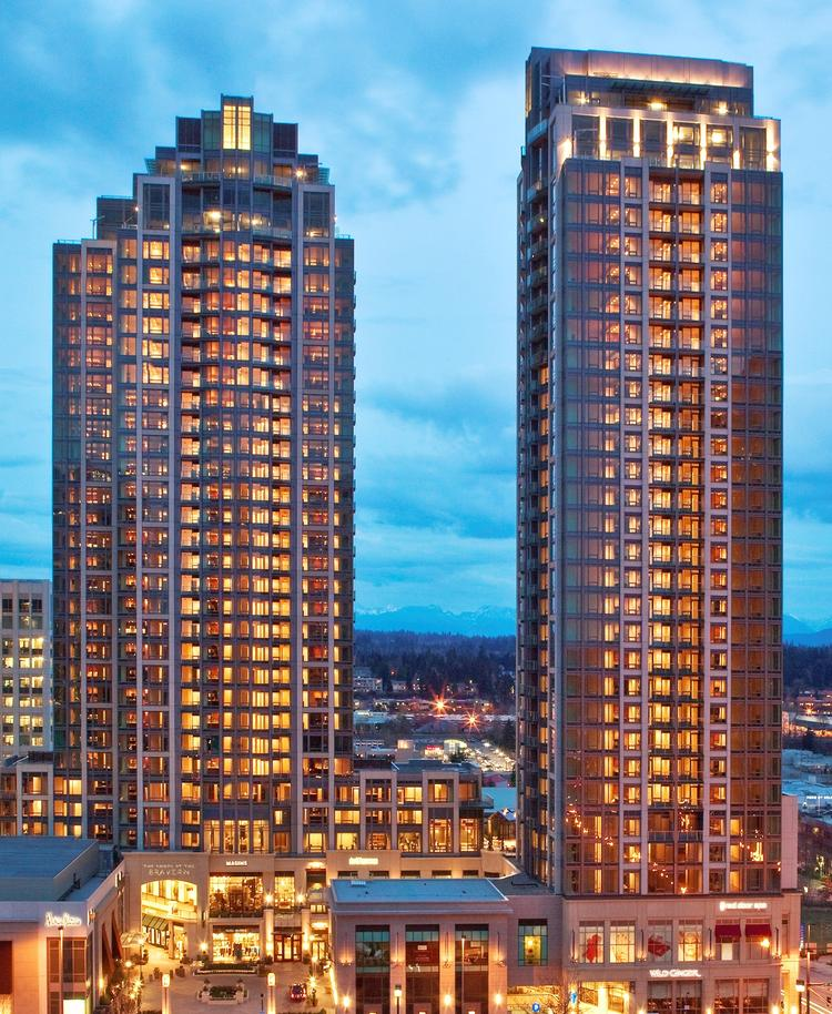 Schnitzer West and a partner sold the Bravern apartments in downtown Bellevue for a record price Tuesday.