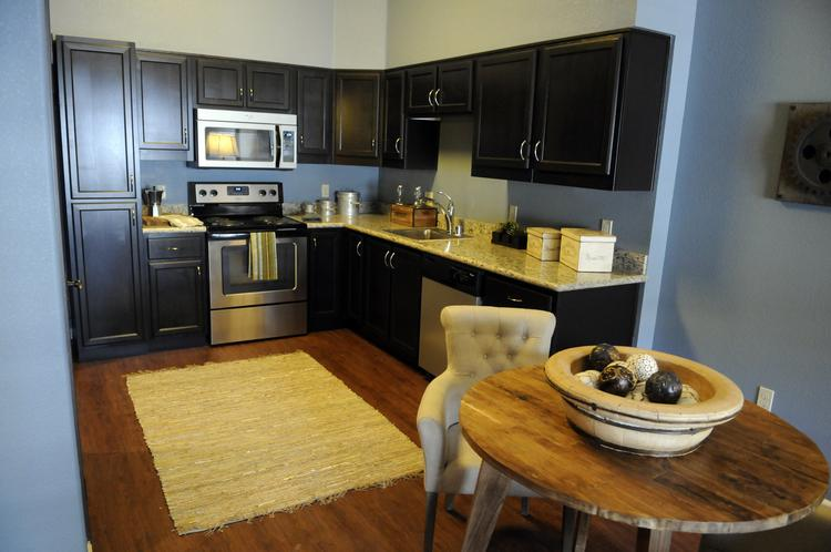 Legado de Ravel, a pair of multi-story mixed-use buildings lining 16th Street between N and P streets, has 84 units, with either one or two bedrooms. This is the kitchen of a one-bedroom apartment.