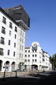 Legado de Ravel, a pair of multi-story mixed-use buildings lining 16th Street between N and P streets, is seen from the outside.